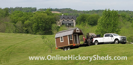 Hickory Shed being towed up a hillside