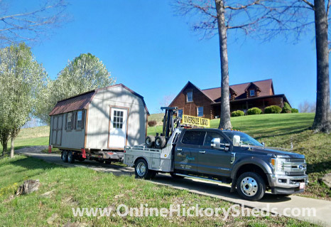 A Hickory Shed being towed by a house