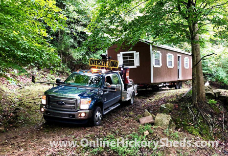 A Hickory Shed being towed through the woods