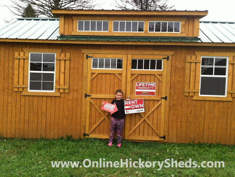 A young girl happy with her new Hickory Shed