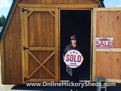 A woman happy with her new Hickory Shed