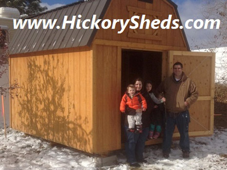 A family happy with their new Hickory Shed