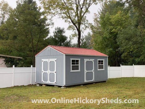 Hickory Sheds Utility Shed with Rustic Red Metal Roof